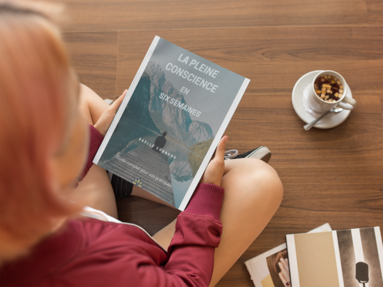 mockup-of-a-girl-holding-a-book-while-sitting-down-on-a-wooden-floor-a14364
