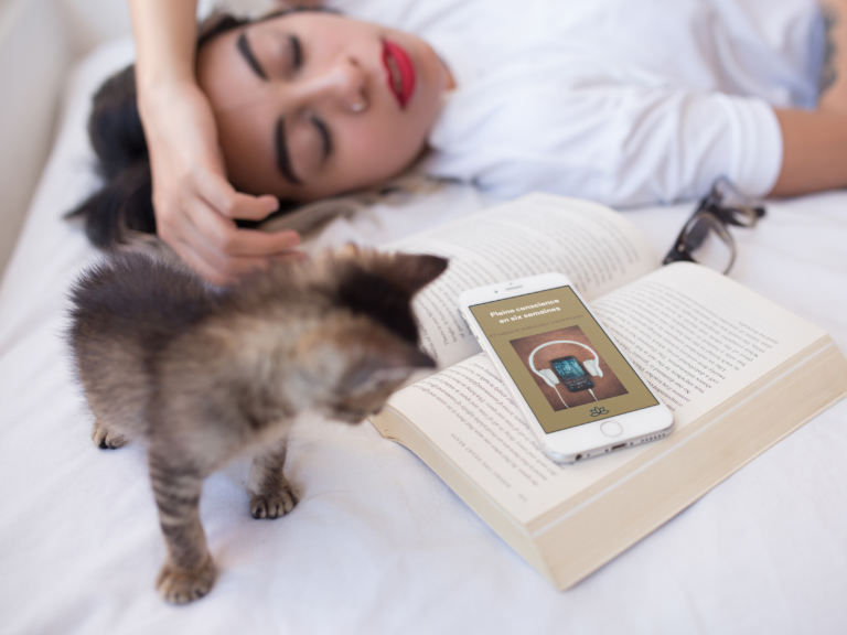 white-iphone-6s-mockup-of-a-woman-sleeping-on-her-bed-with-a-kitten-and-a-book-a12800